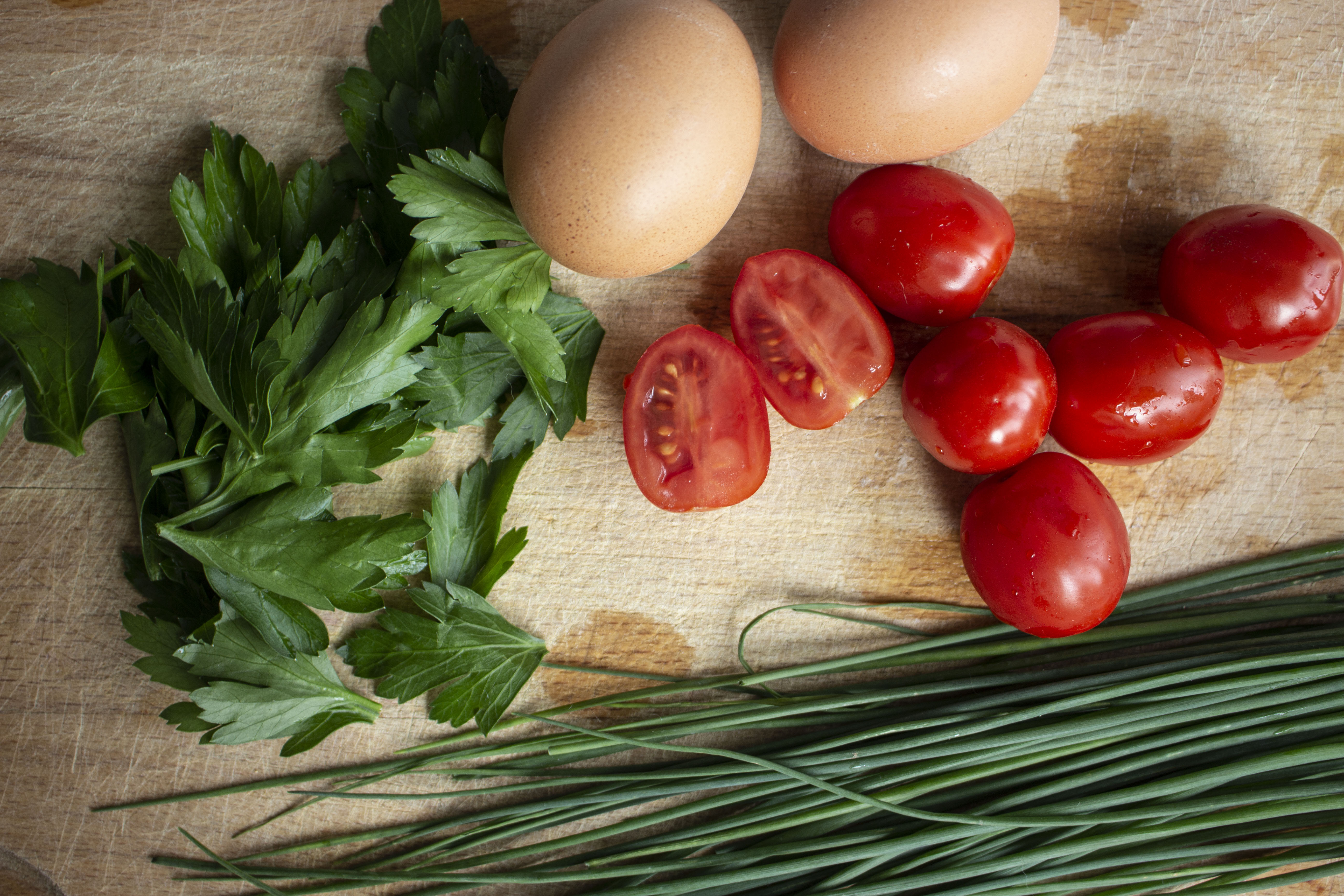 ingredients eggs, chives, parsley, cherry tomatoes