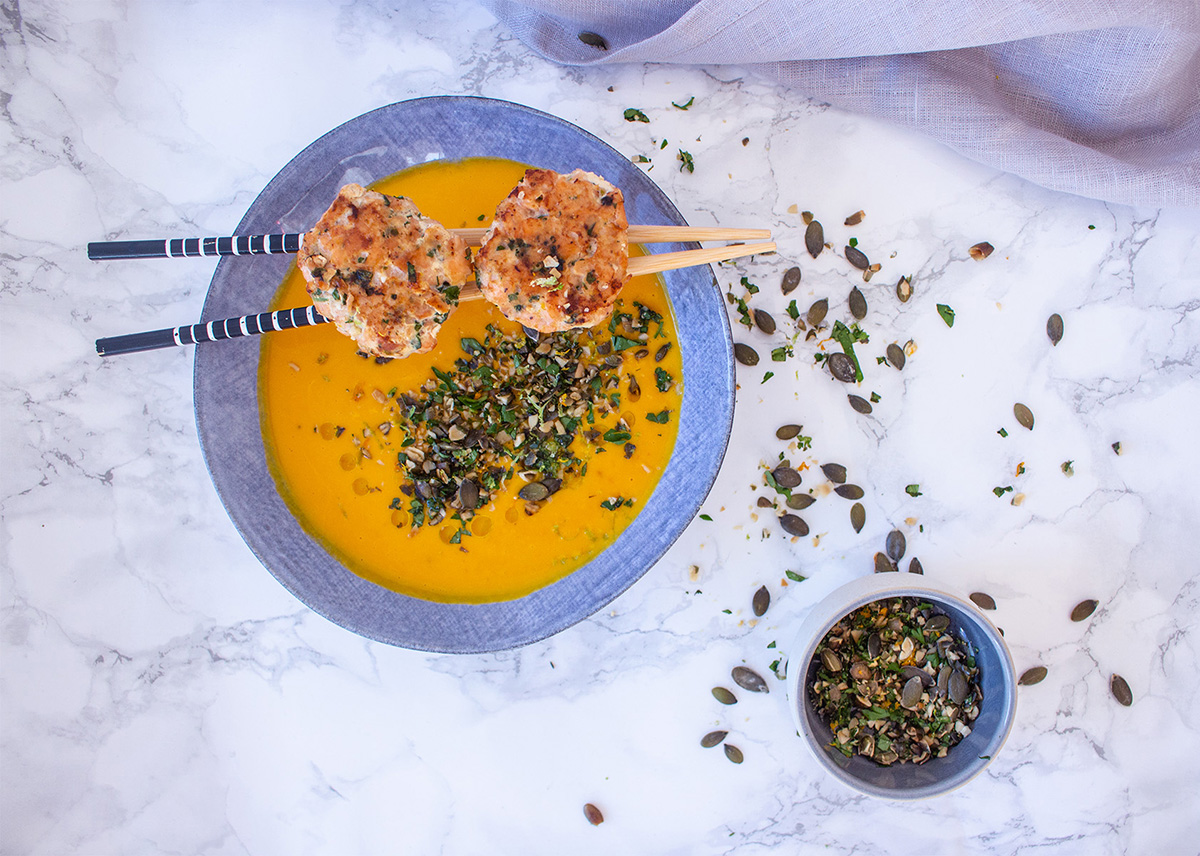 Pumpkin Soup with Salmon Meatballs in a blue Stone wear plate