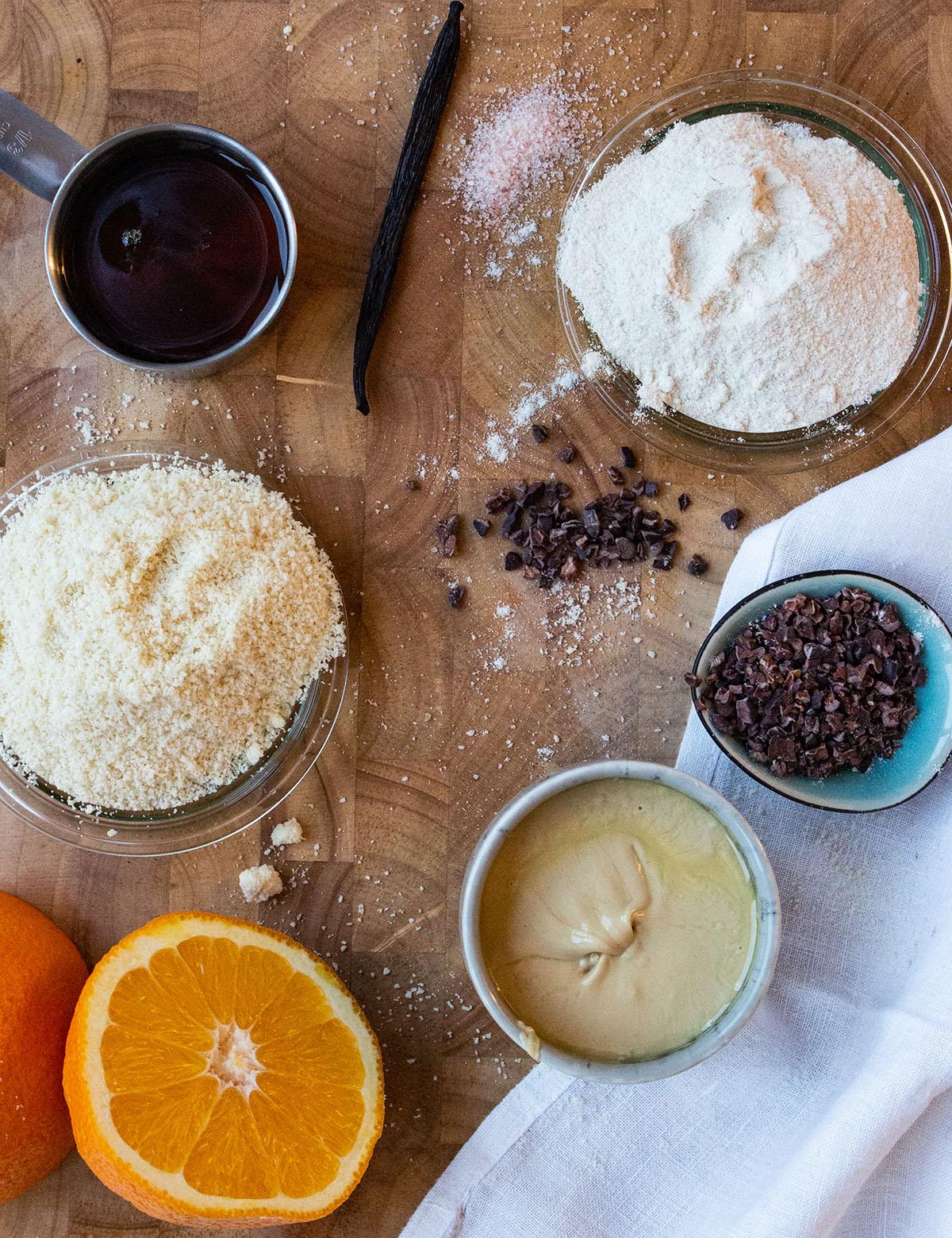ingredients chocolate Cookies vegan maple syrup, almond flour, Rice flour, vanilla bean, pink salt, orange, Cashew butter