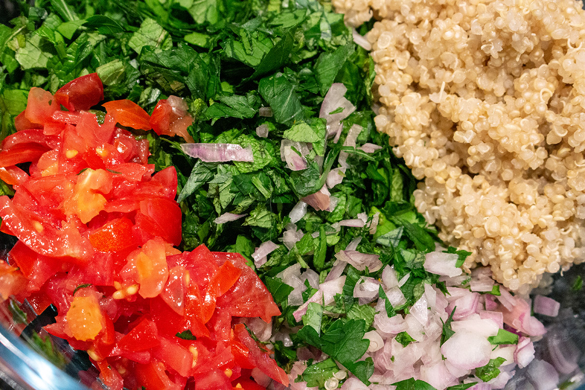 chopped tomato, chopped mint and parsley, cooked quinoa